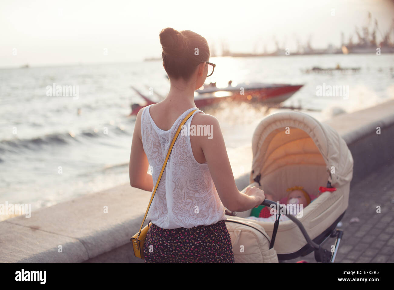 Mother strolling with newborn - Stock Image