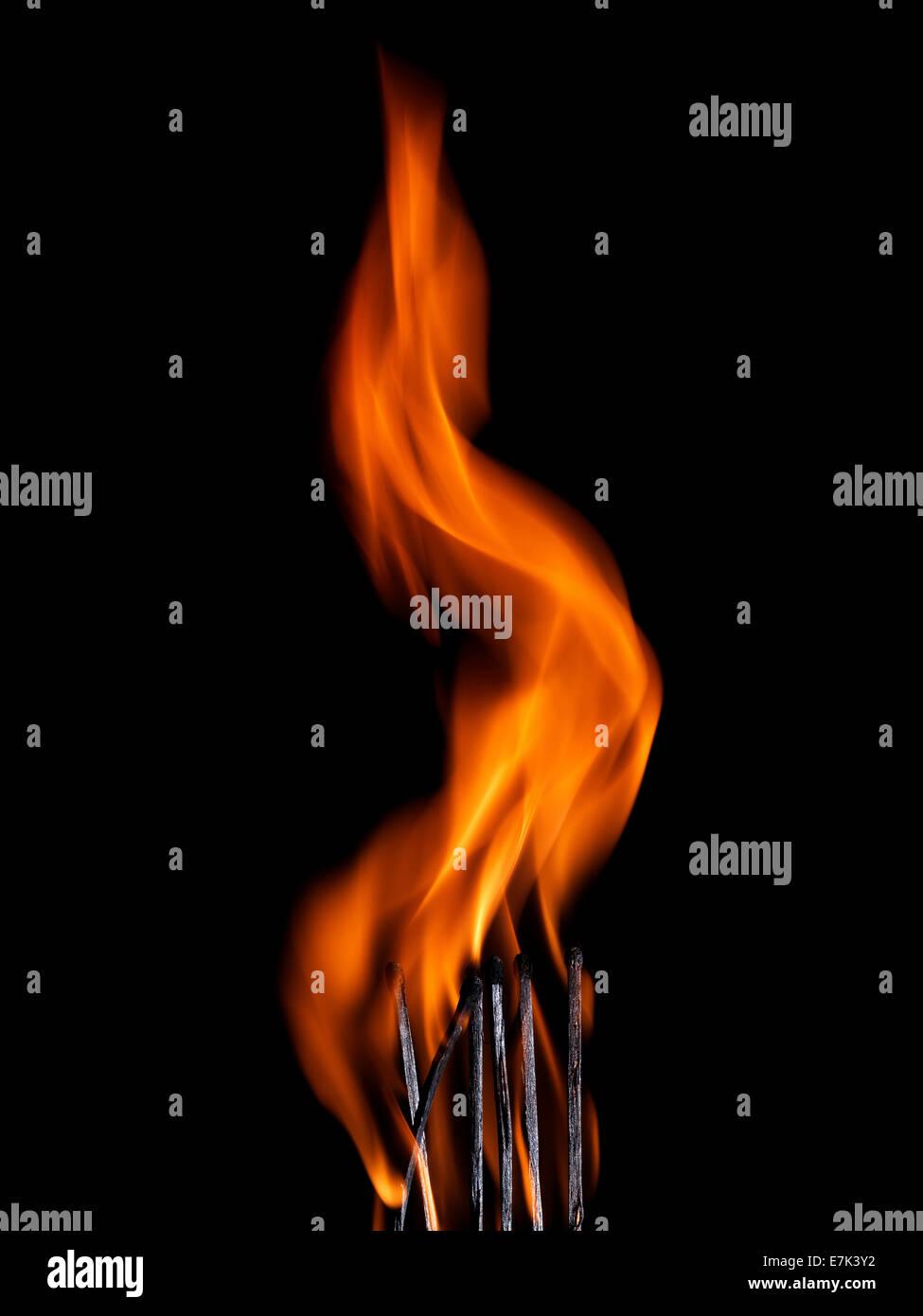 Macro shot of a flaming matchstick - Stock Image