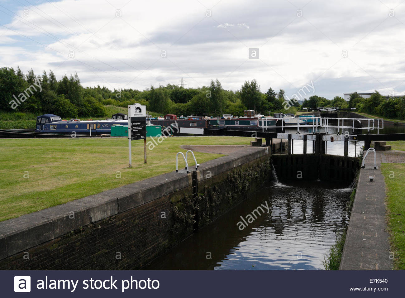 Canal boats moored at Tinsley Lock on the Sheffield canal - Stock Image