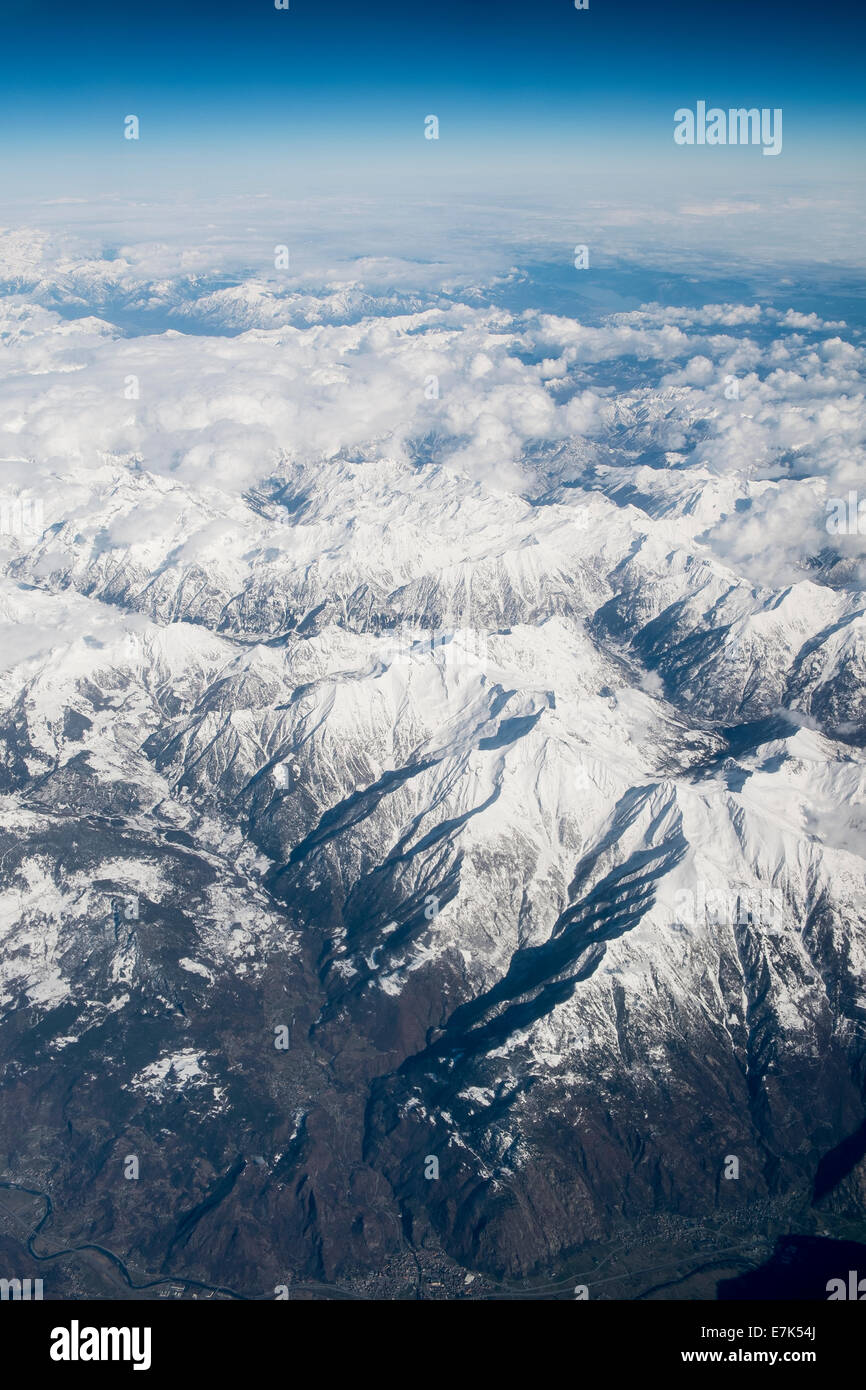 aerial view snow alps mountains from sky air above - Stock Image