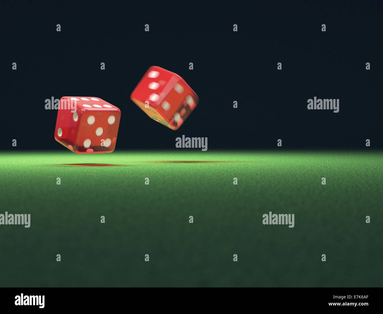 Two red dice thrown on green table. Your text on the empty space. - Stock Image