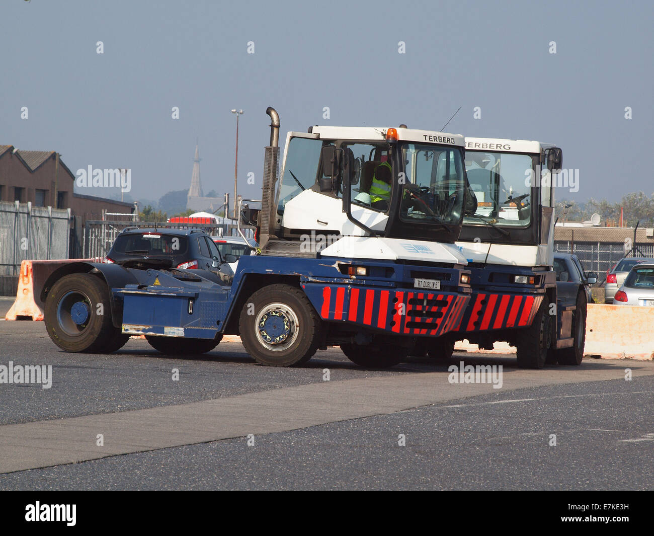 Two portside tractor vehicles stationary at Don Laoghaire Port, Dublin, Ireland, awaiting shipment  movements. - Stock Image