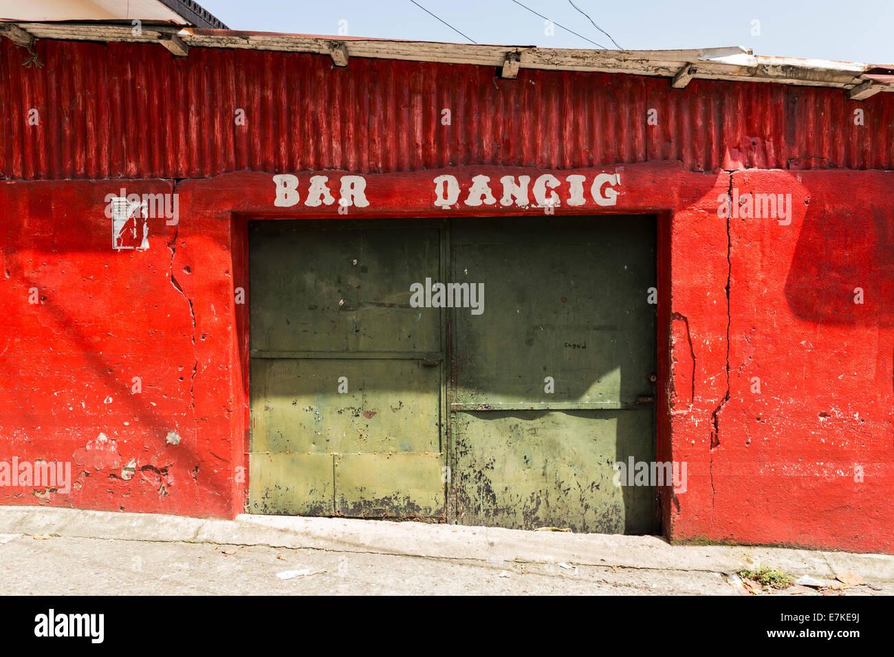 Closed door of a bar in Livingston, Guatemala - Stock Image