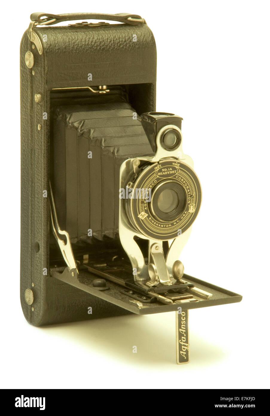 Vintage Agfa Ansco folding bellows film camera against white background - Stock Image