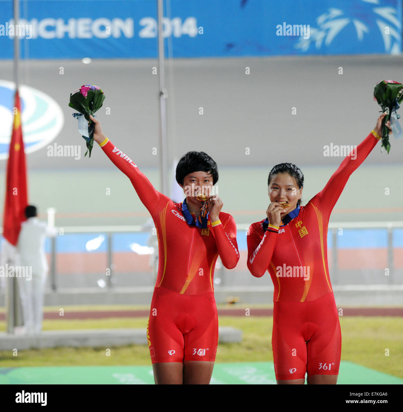 Incheon, South Korea. 20th Sep, 2014. Zhong Tianshi (L) and Gong Jinjie of  China pose on the podium during the awarding ceremony of Women's Team  Sprint competition of cycling track at the