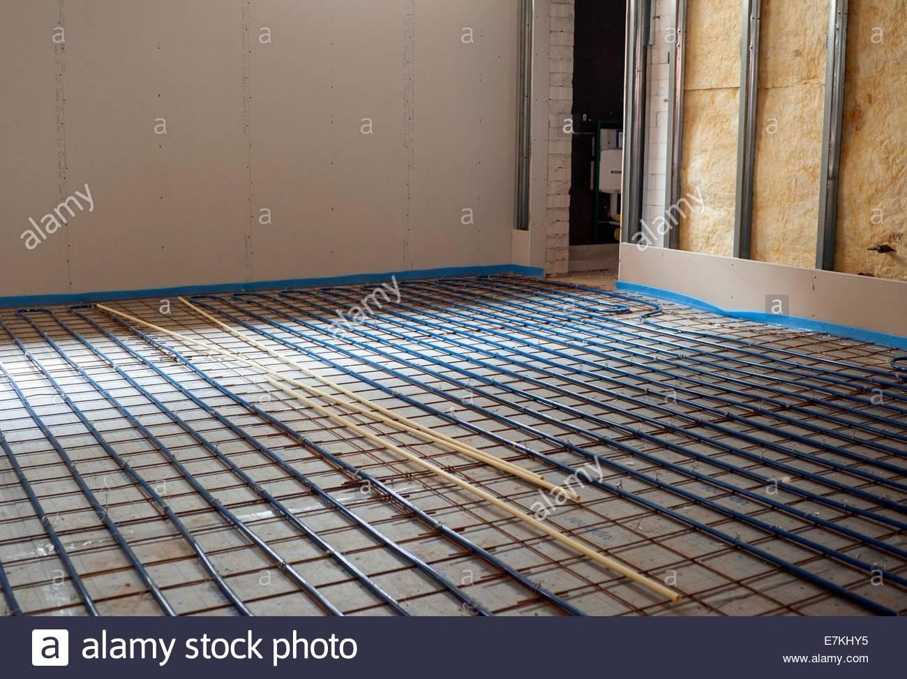 Underfloor heating being laid. - Stock Image