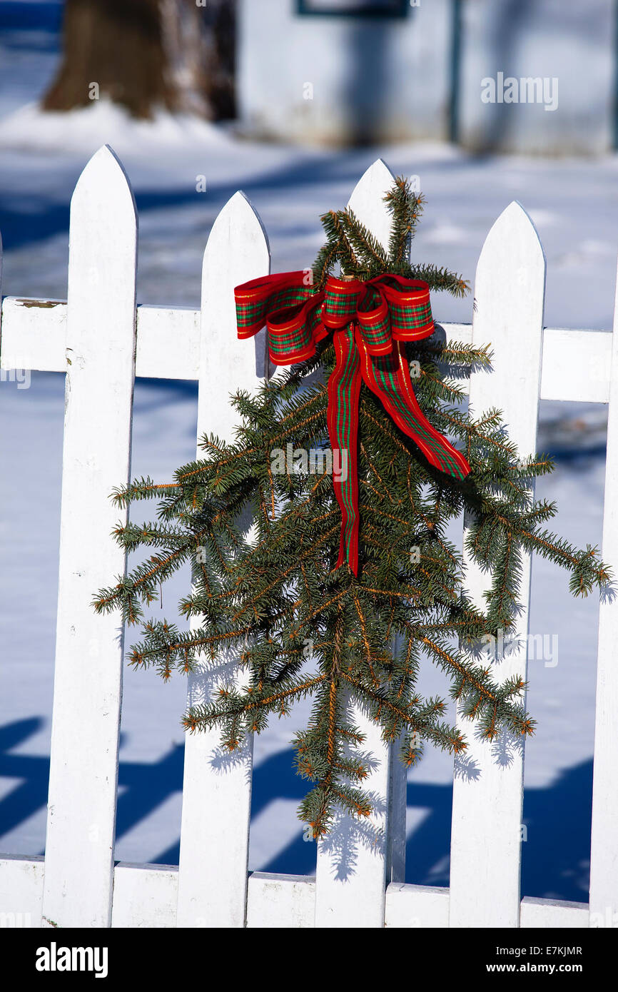 Image of: Christmas Outdoor Decoration Pine And Red Ribbon On White Picket Stock Photo Alamy