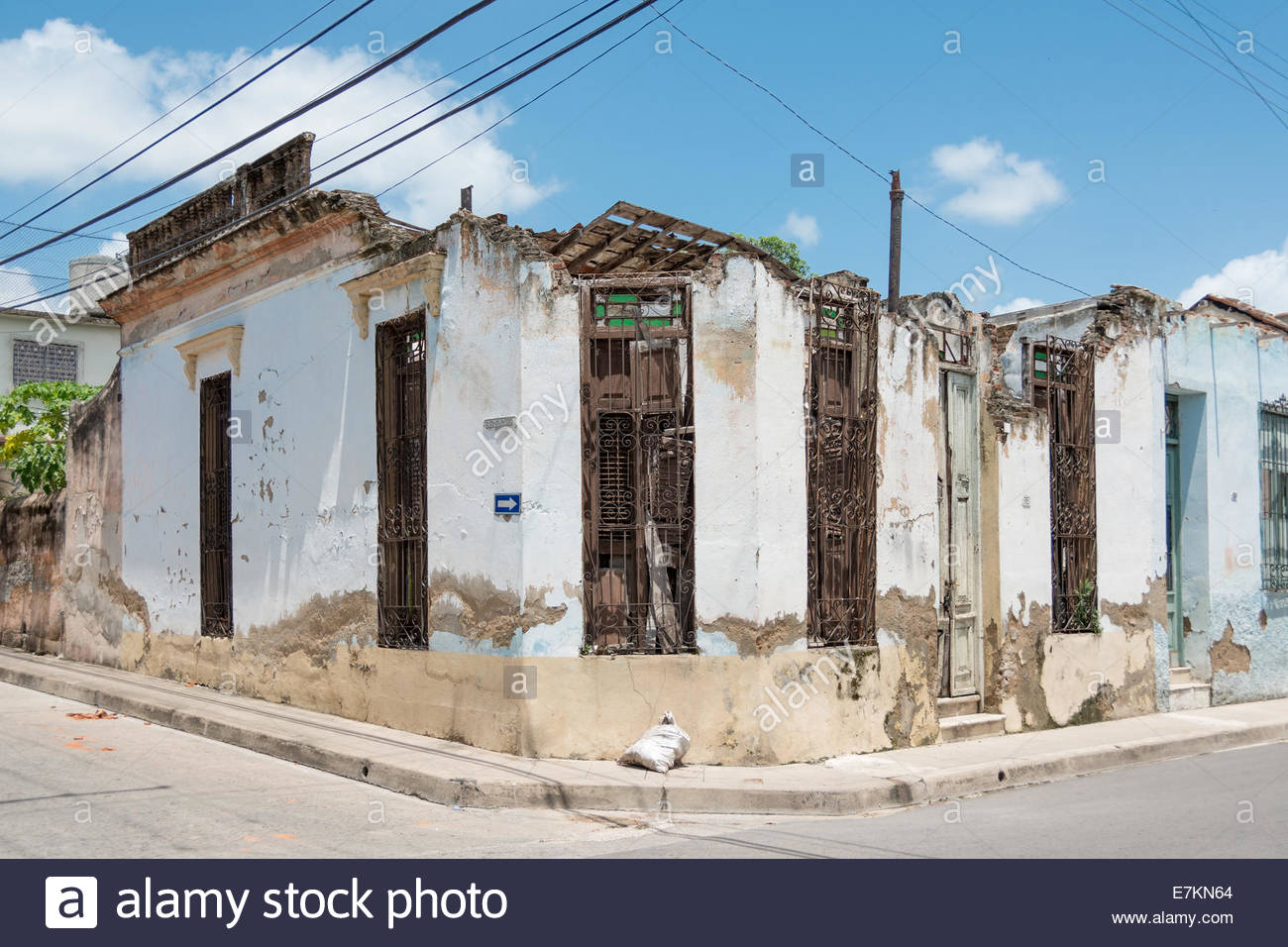 Old colonial houses falling apart due to lack of maintenance - Stock Image