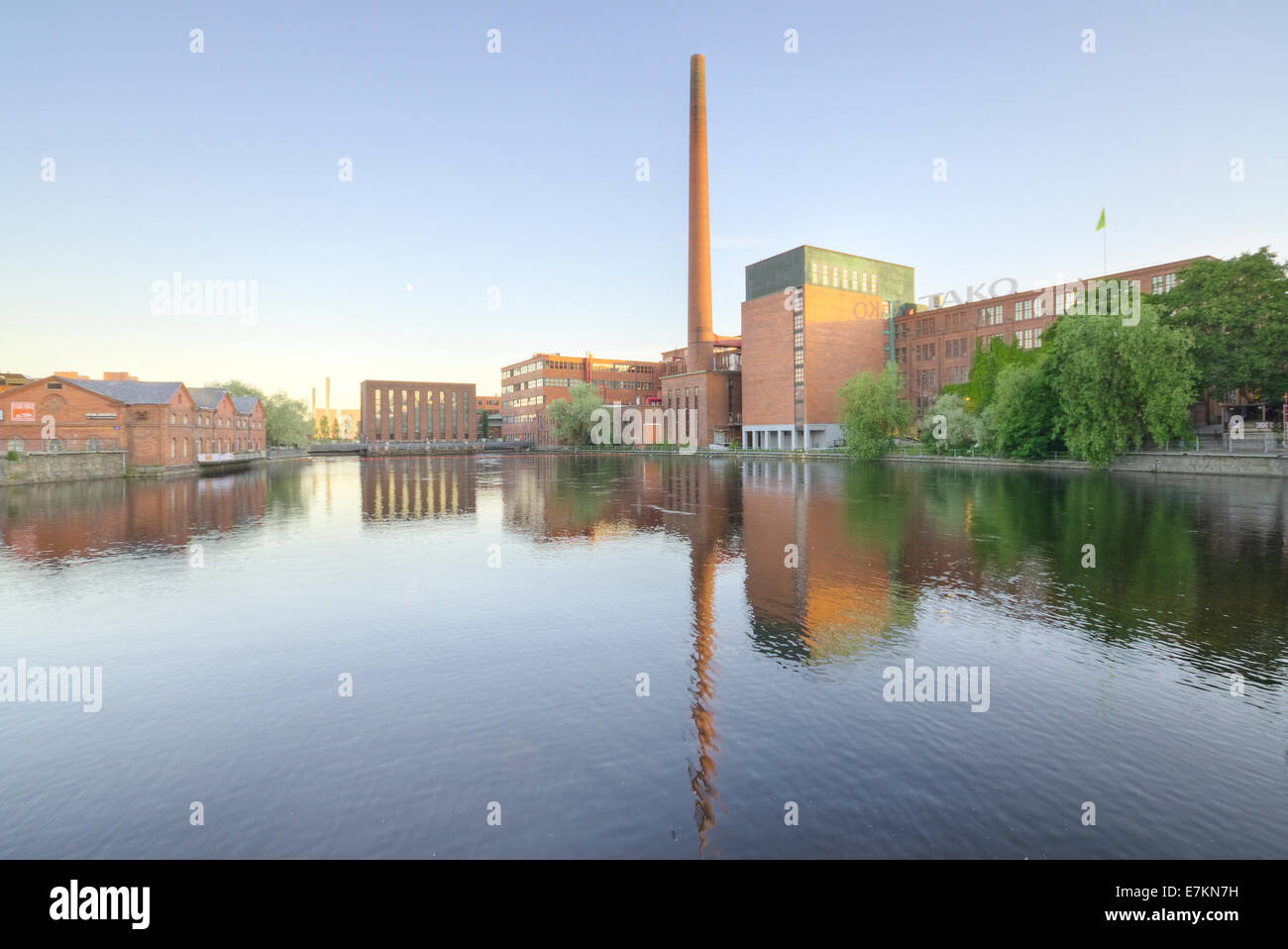 Landscape of an old brick factory and lake reflection at dusk in Tampere Finland - Stock Image