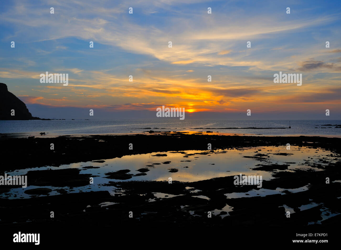 Sunset seen from the foreshore at Gardenstown, Moray Firth, Aberdeenshire, Scotland, UK - Stock Image