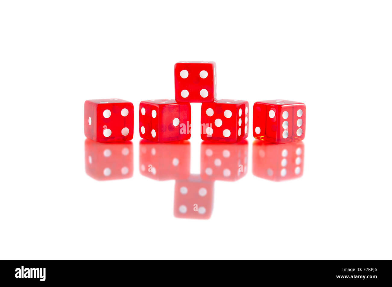 Red dice on white isolated background with beautiful reflection. Stock Photo