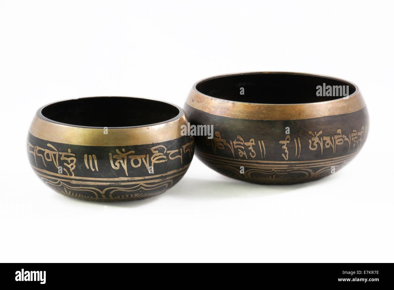 Tibetan Bowls isolated on white background - Stock Image