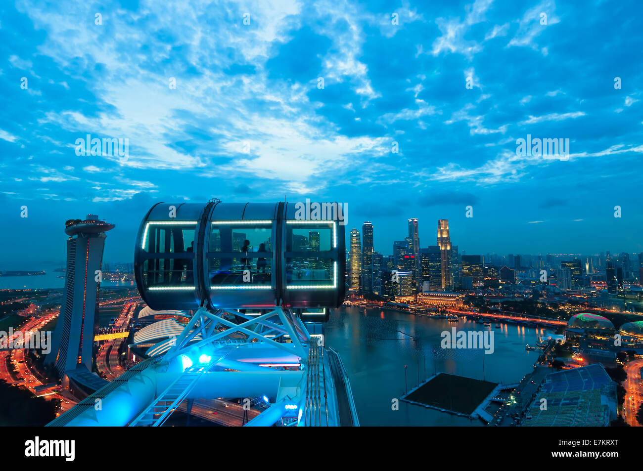 Looking out over Singapore at sunset from the Singapore Flyer. - Stock Image