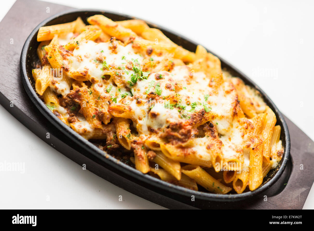 baked penne pasta with meat and cheese - Stock Image