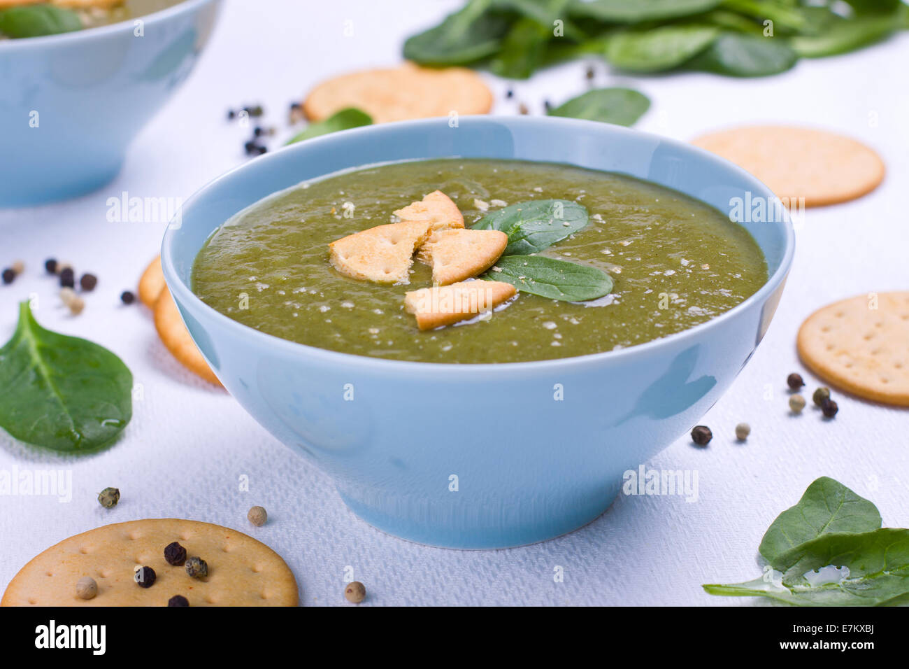 Pureed spinach soup in a bowl - Stock Image