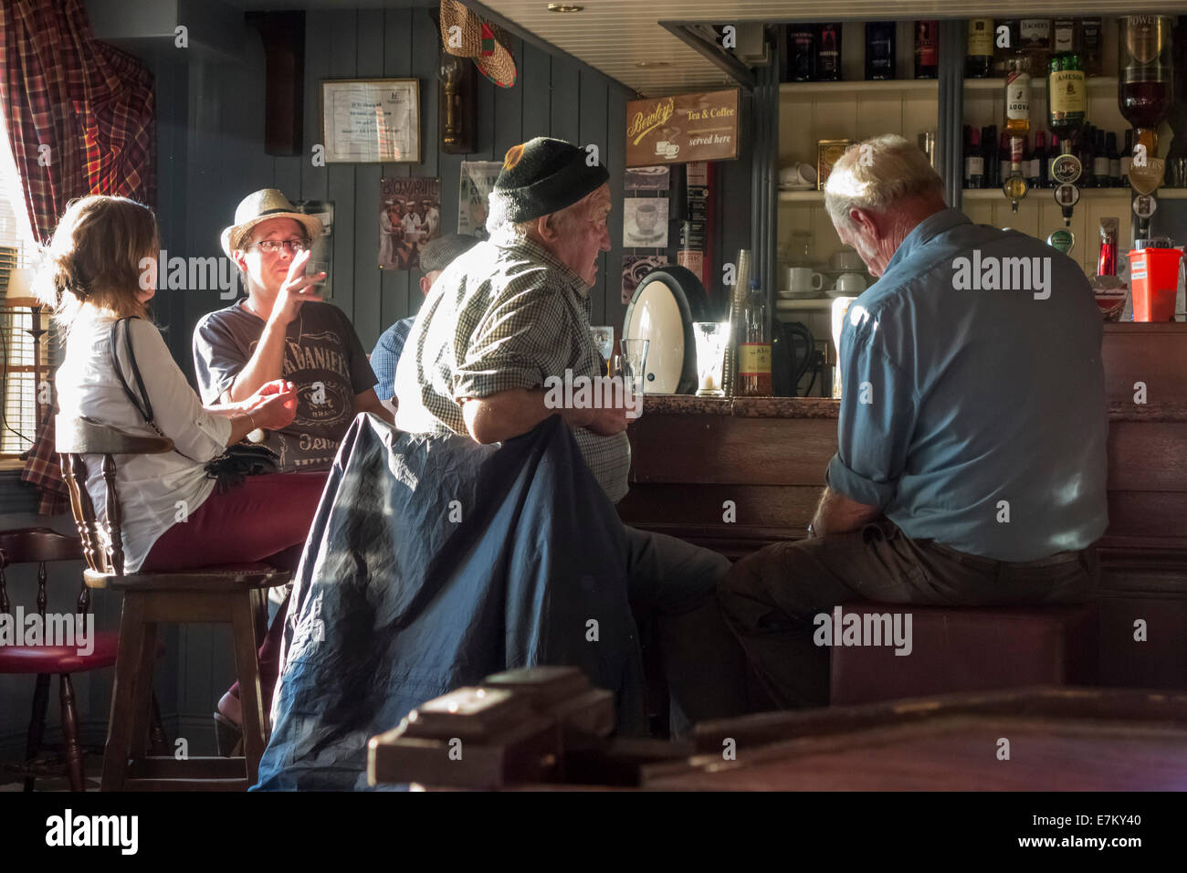 Drinkers in a traditional pub in the centre of Killorglin, County Kerry, Republic of Ireland - Stock Image