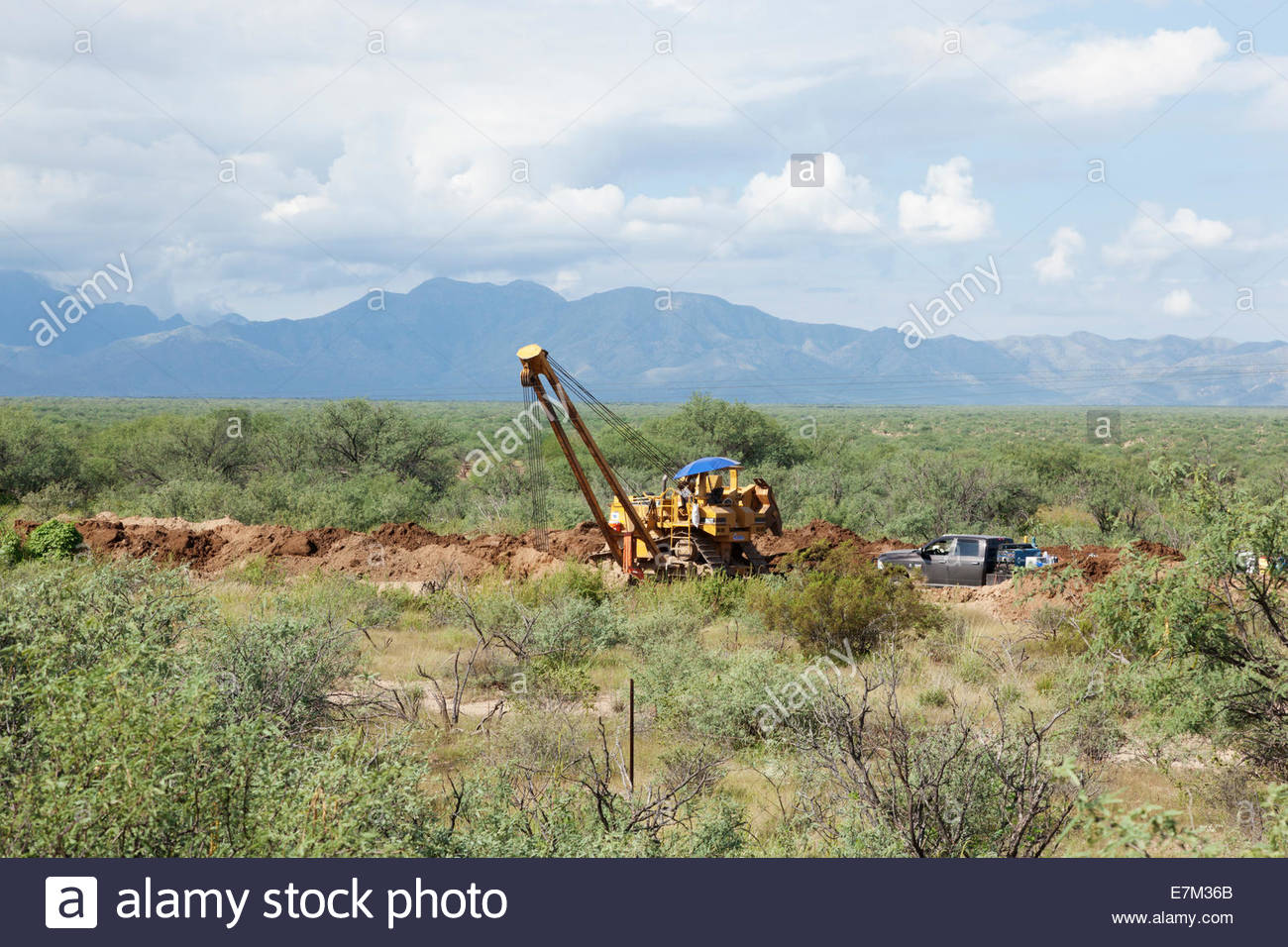 caterpillar cat sideboom pipelayer 583t pipeline construction welding machine on pickup truck operator visible arizona