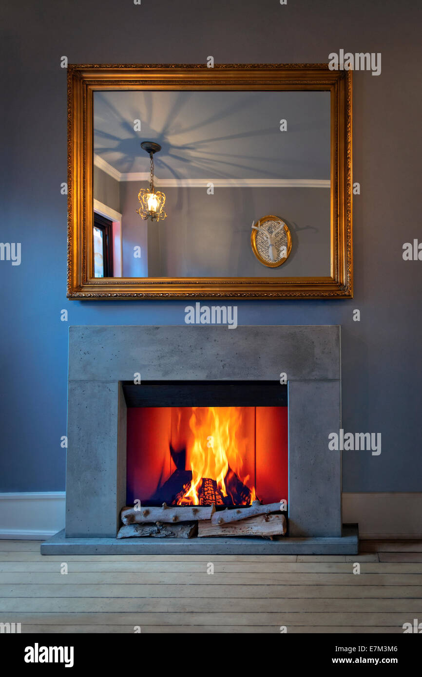 Fireplace with mirror - Stock Image
