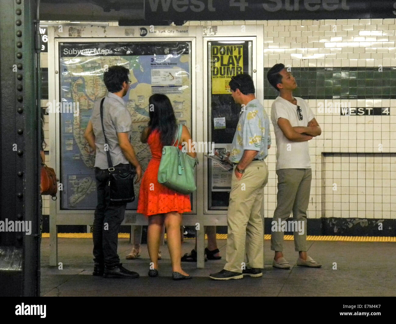 Ny Street And Subway Map.Asian American Tourists In New York City Read A Subway Map At West