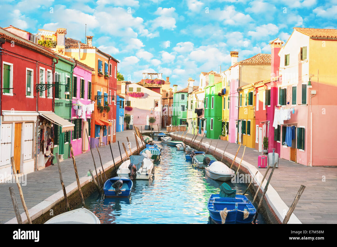 Narrow canal and colorful houses in Burano, Italy. Stock Photo