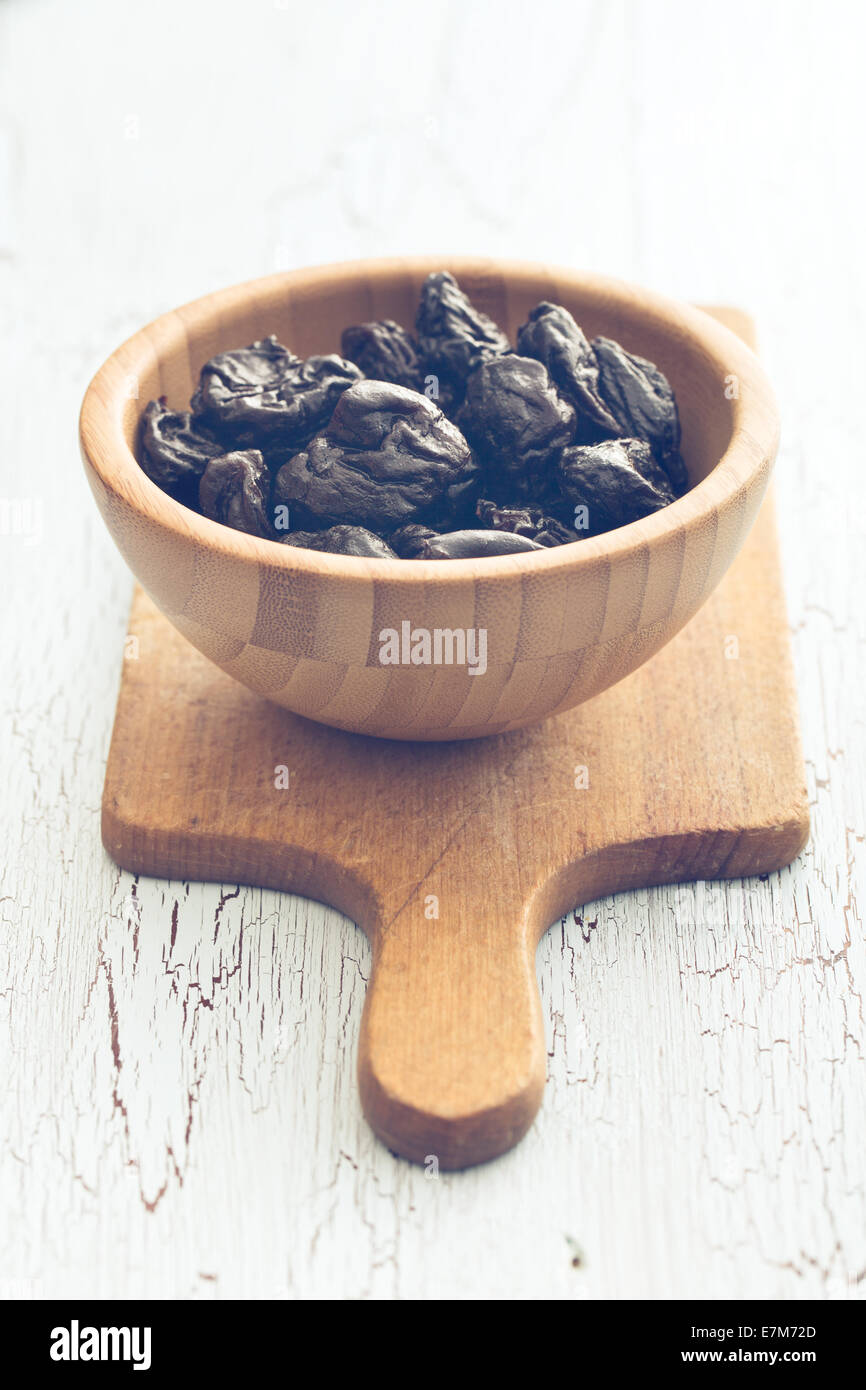 pitted prunes on old table - Stock Image
