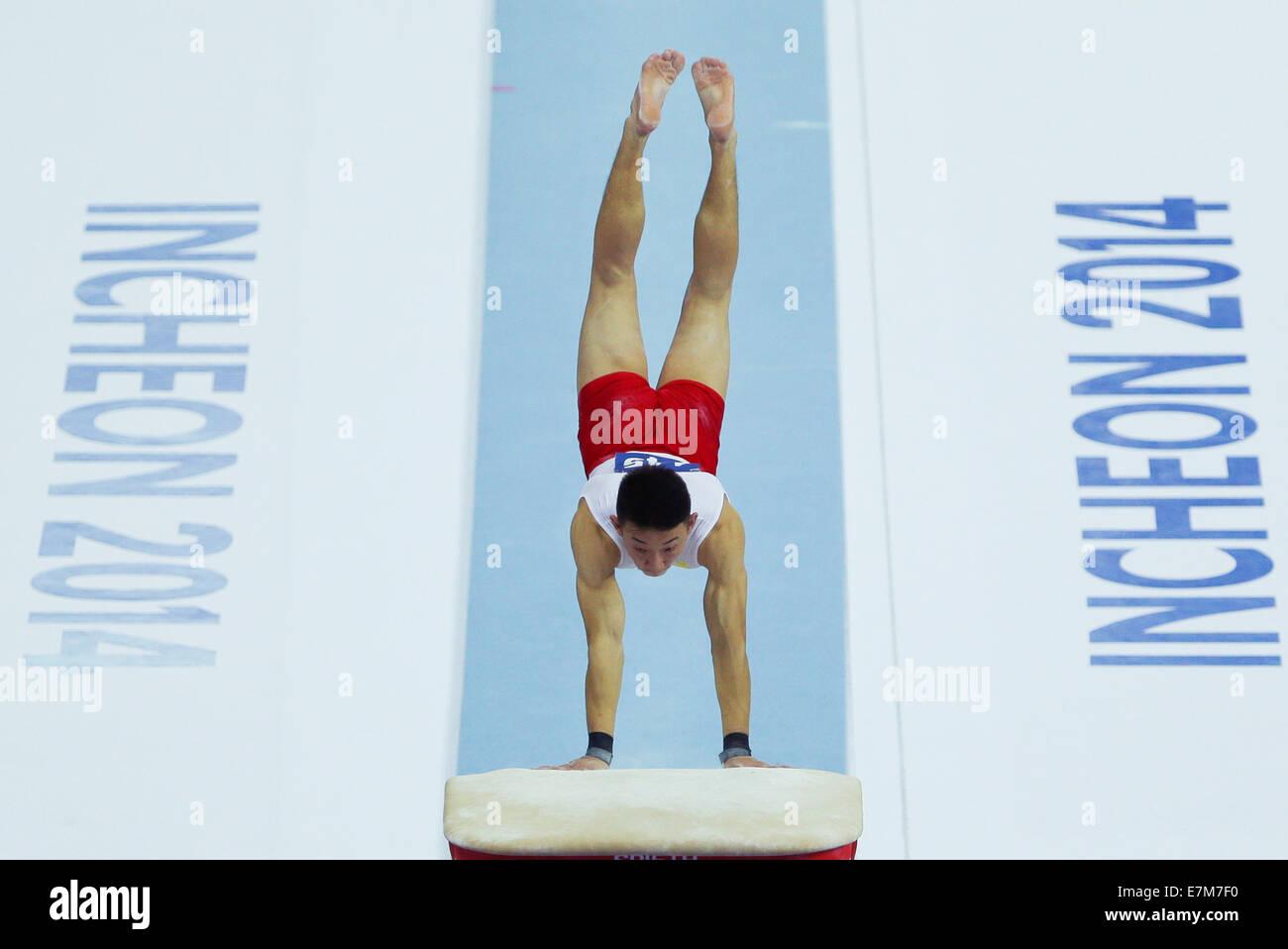 Incheon, South Korea. 21st Sep, 2014. Purevdorj Otgonbat of Mongolia competes during the vault of men's gymnastics Stock Photo