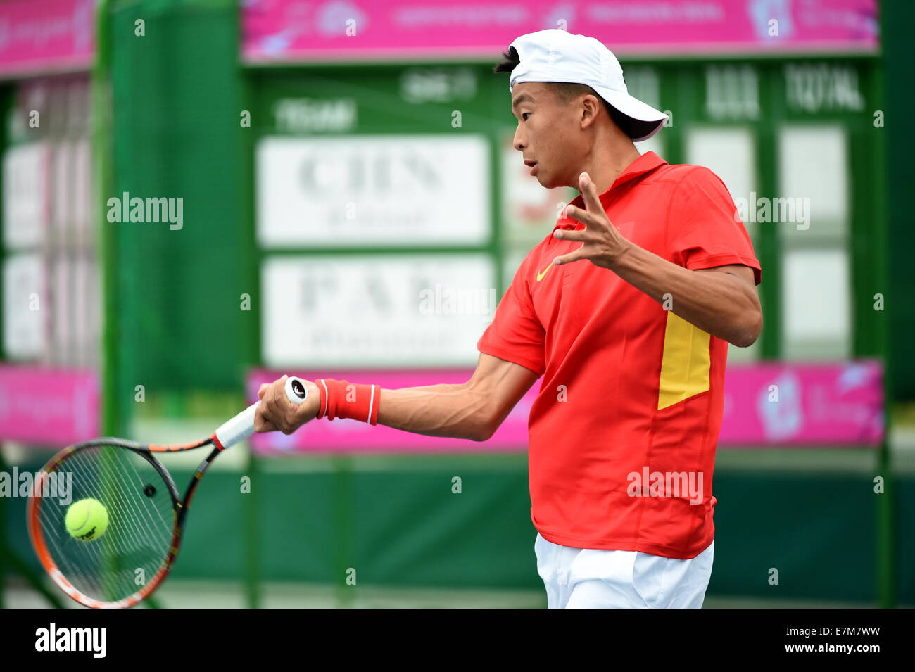 Incheon, South Korea. 21st Sep, 2014. Wu Di of China returns the ball during the men's tennis team second round - Stock Image
