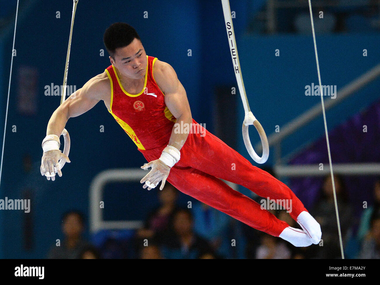 Incheon, South Korea. 21st Sep, 2014. Liao Junlin of China competes during the rings of men's gymnastics artistic Stock Photo