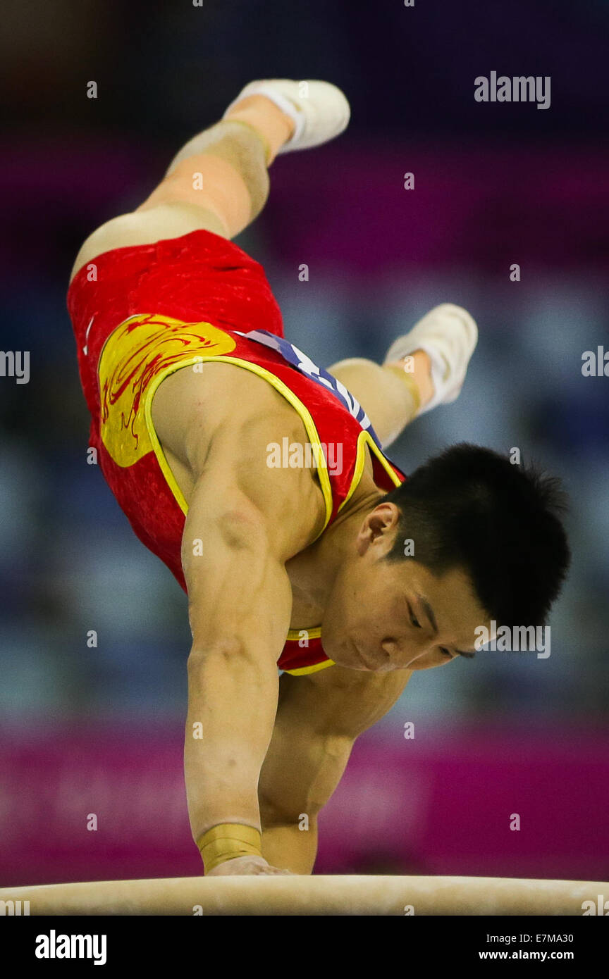 Incheon, South Korea. 21st Sep, 2014. Huang Yuguo of China competes during the vault of men's gymnastics artistic Stock Photo