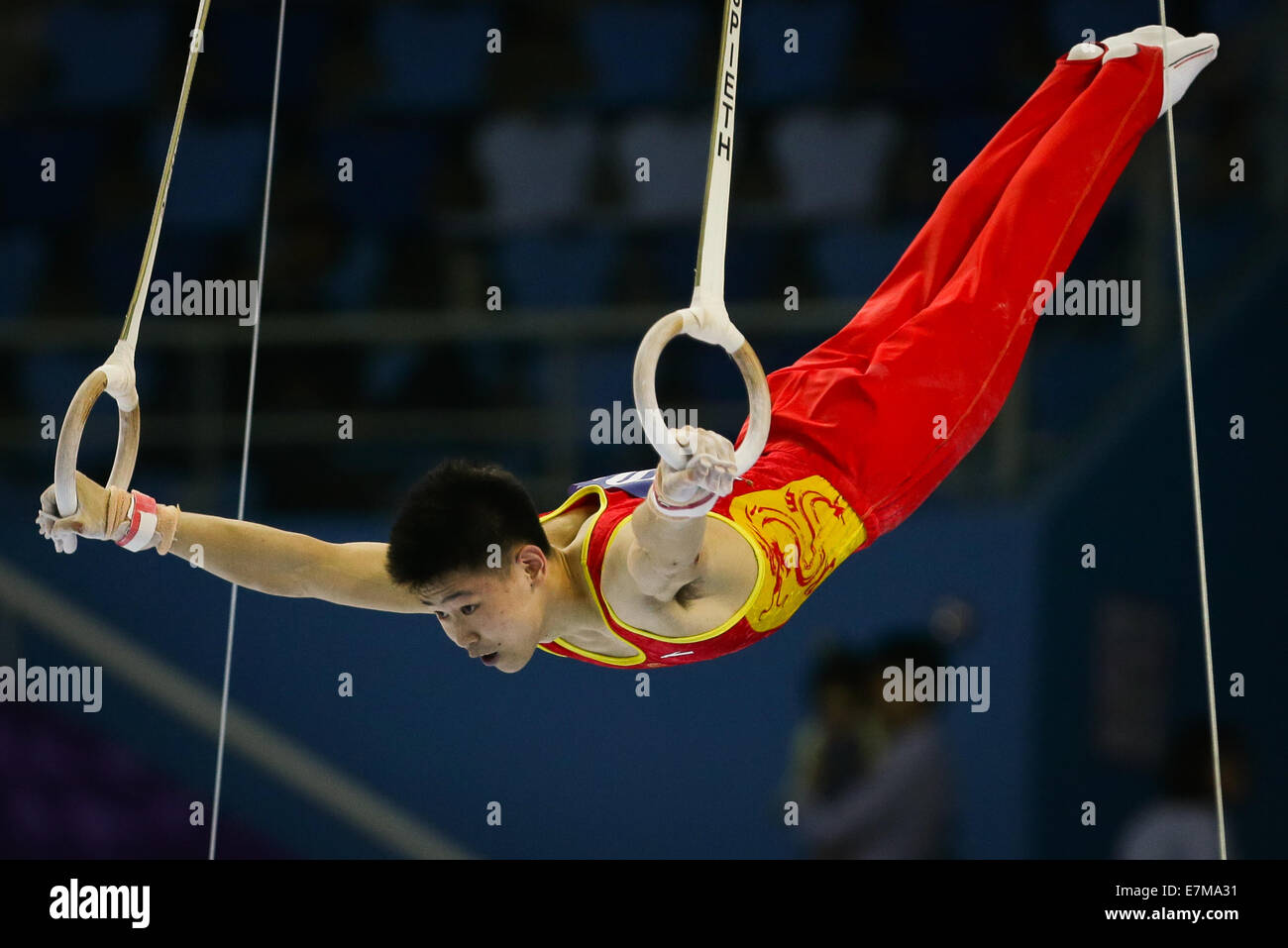 Incheon, South Korea. 21st Sep, 2014. Wang Peng of China competes during the rings of men's gymnastics artistic Stock Photo