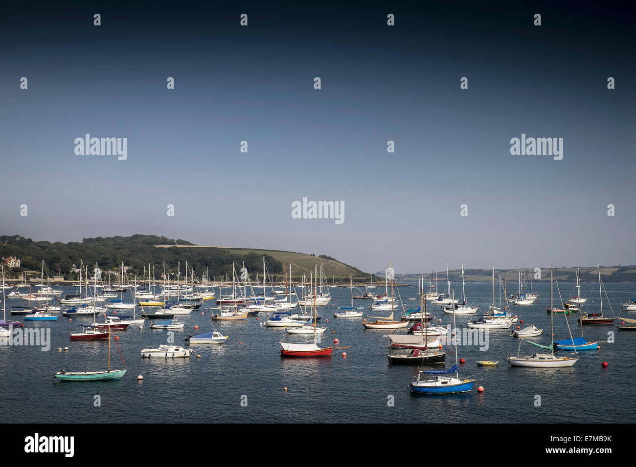Boats moored in Carrick Roads in Falmouth. - Stock Image