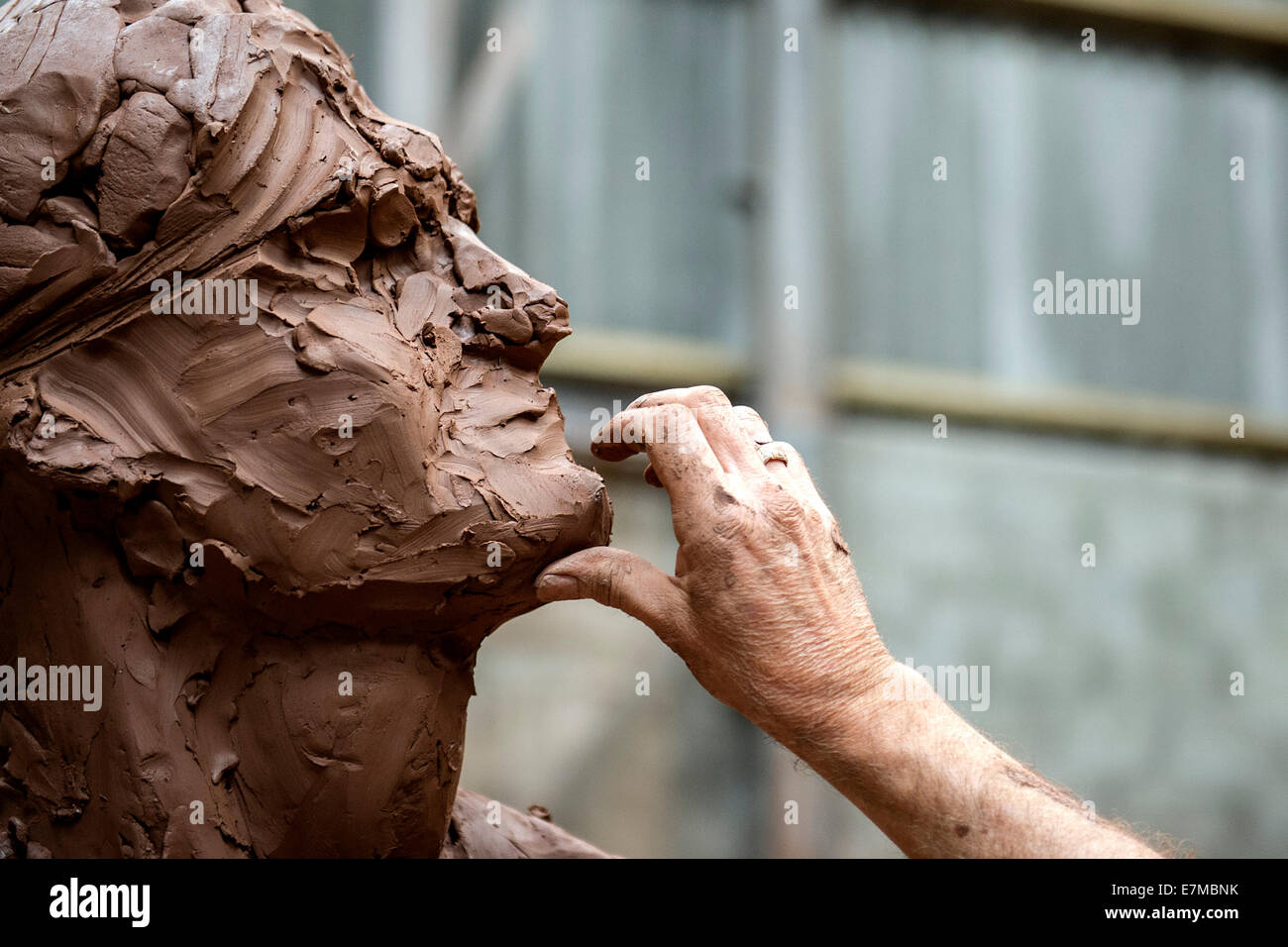 Colin Caffell, a sculptor working on his Tin Mining Memorial sculpture. - Stock Image