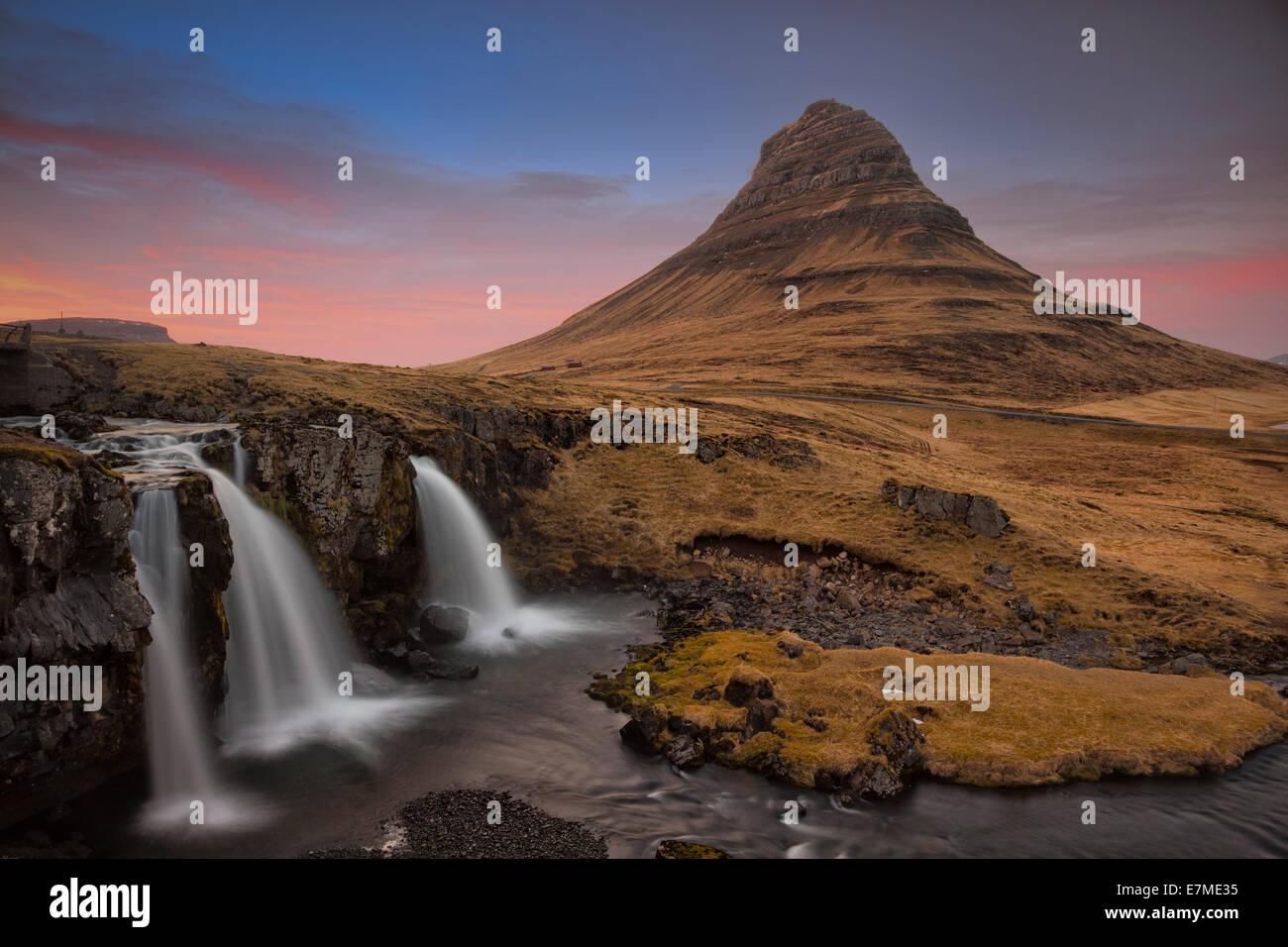 The Kirkjufell mountain and waterfall near Grundarfjordur in twilight, Snaefellsnes Peninsula, in western Iceland. - Stock Image