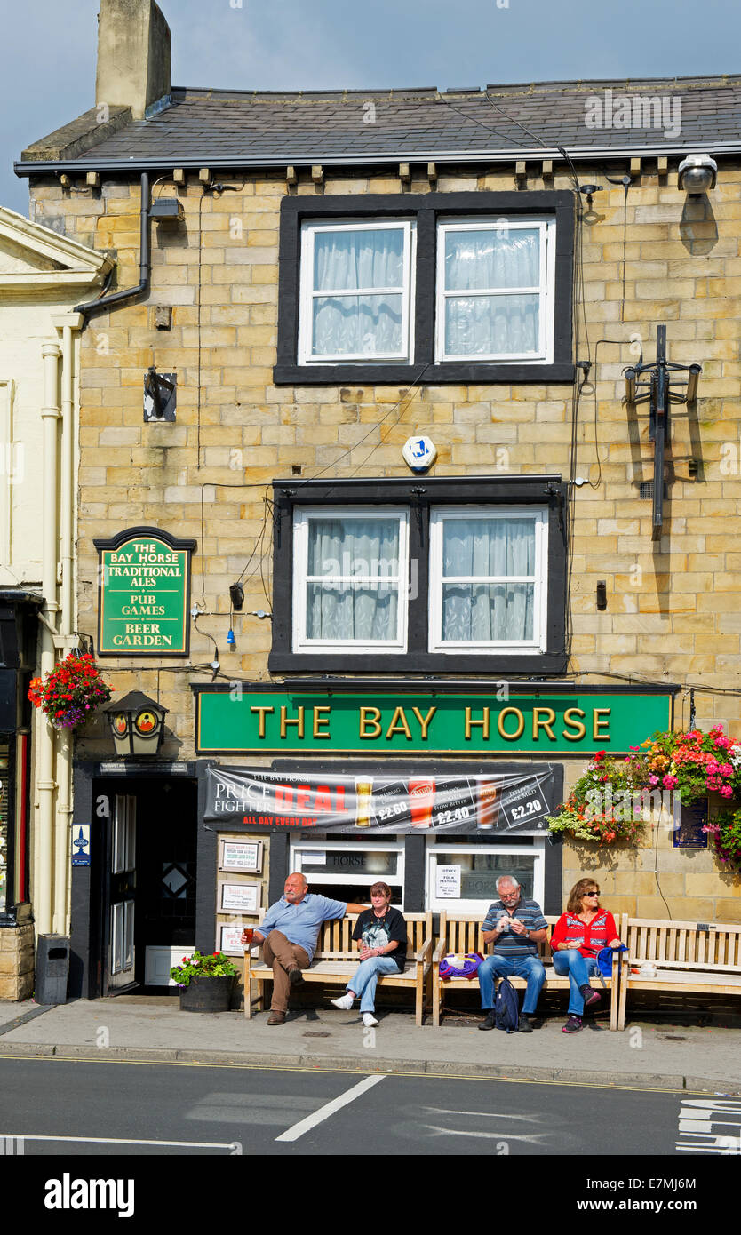 Drinkers sitting outside the Bay Horse pub, Otley, West Yorkshire, England UK - Stock Image