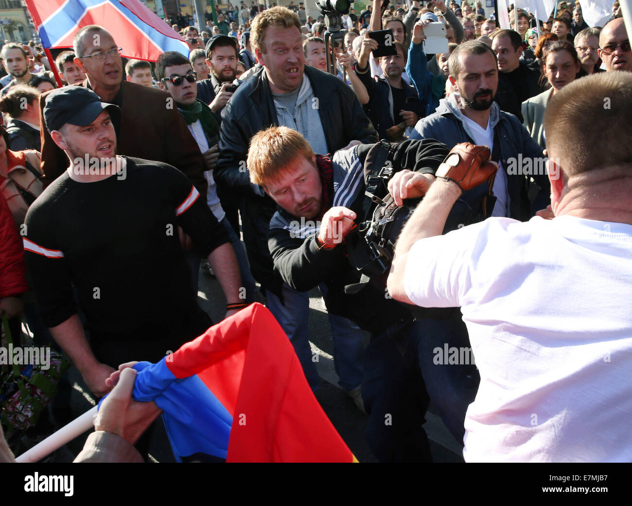 ITAR-TASS: MOSCOW, RUSSIA. SEPTEMBER 21, 2014. A fight during the Peace March against the war in Ukraine. (Photo Stock Photo