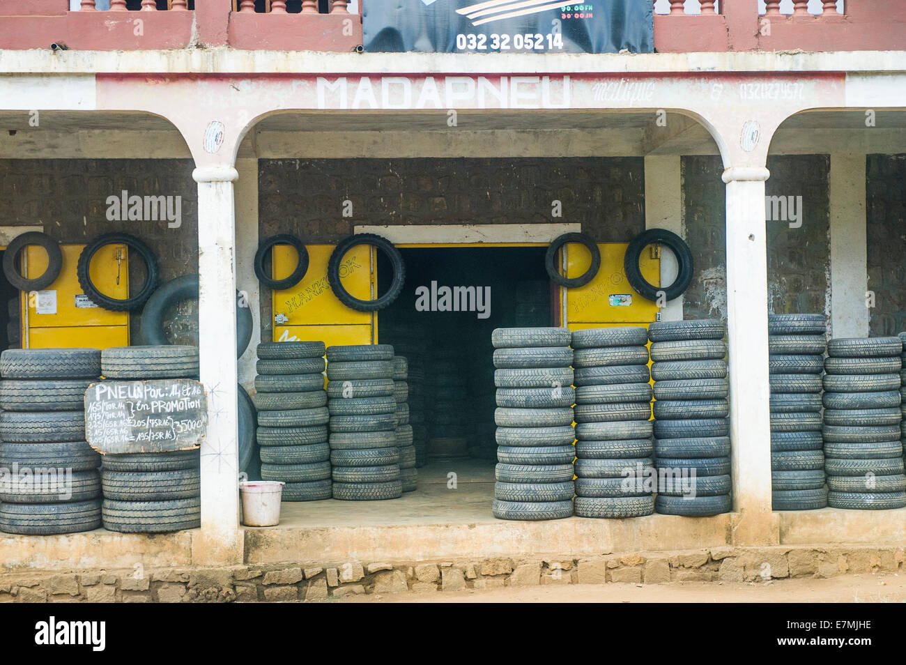 Outside a tyre supplier's premises in Madagascar - Stock Image