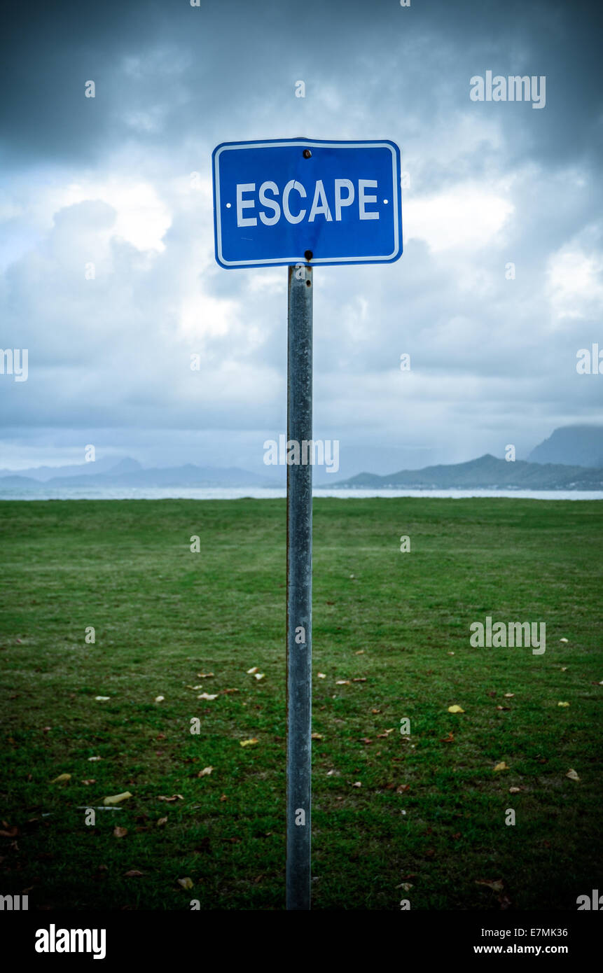 Conceptual Image Of A Grungy Escape Sign In An Empty Wilderness - Stock Image