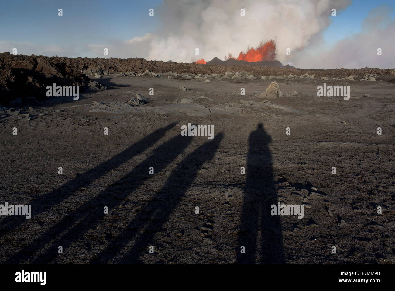 Shadows of the photographers filming the volcano eruption, Holuhraun, north east Iceland - - Stock Image