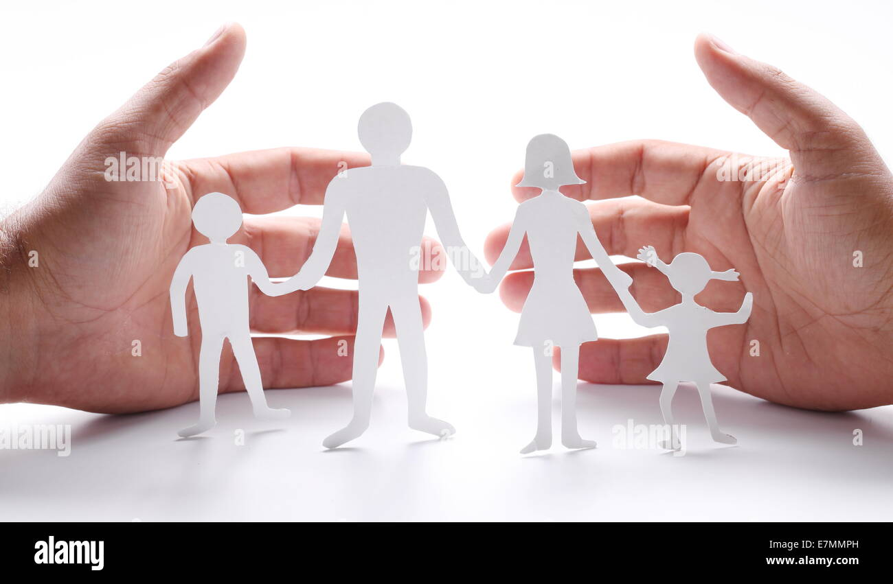 Cardboard Figures Of The Family On A White Background The Symbol Of