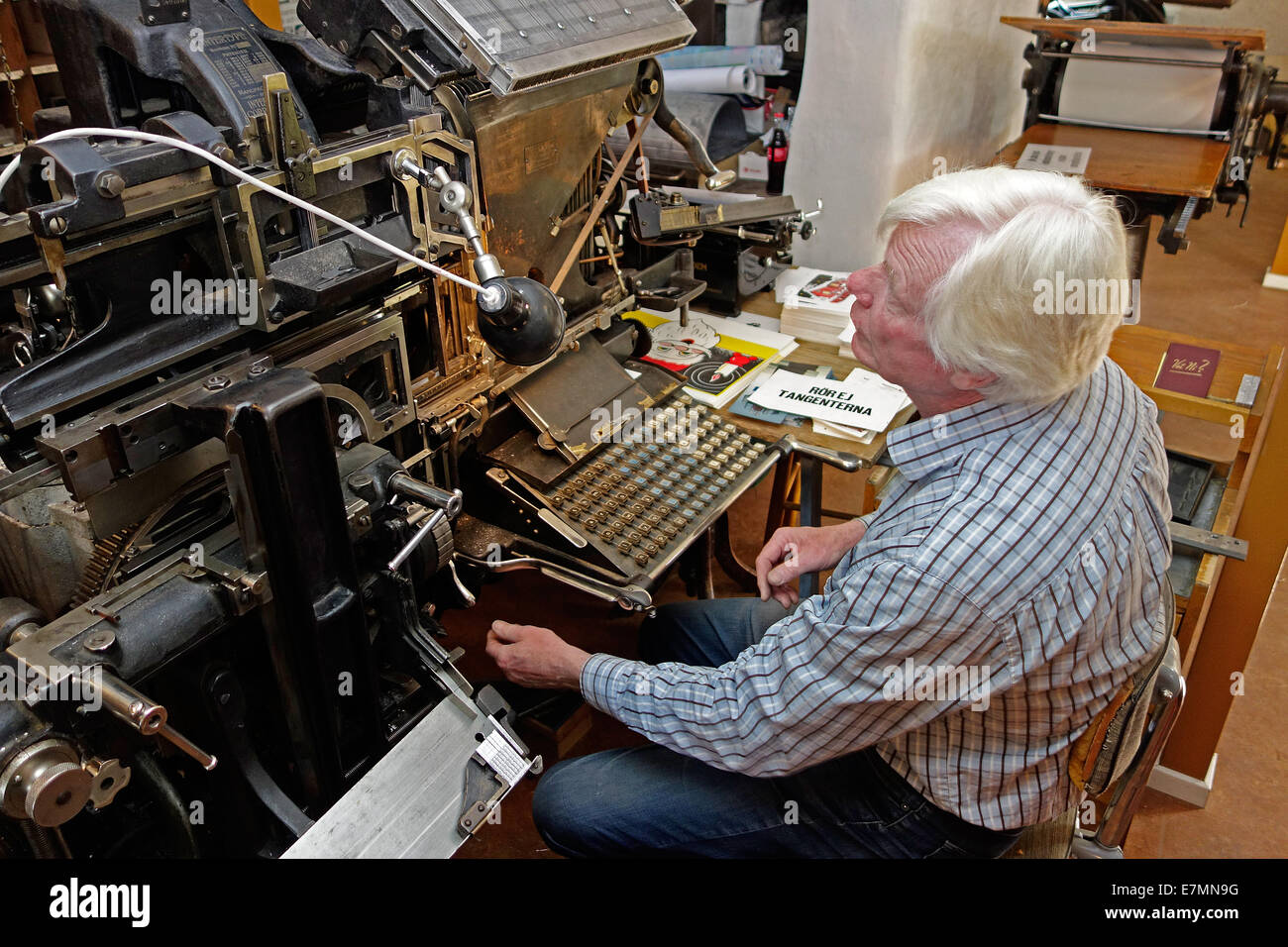 Operator works on old Typesetting Machine by Intertype Corporation, Brooklyn, N.Y.  from  1916 - Stock Image