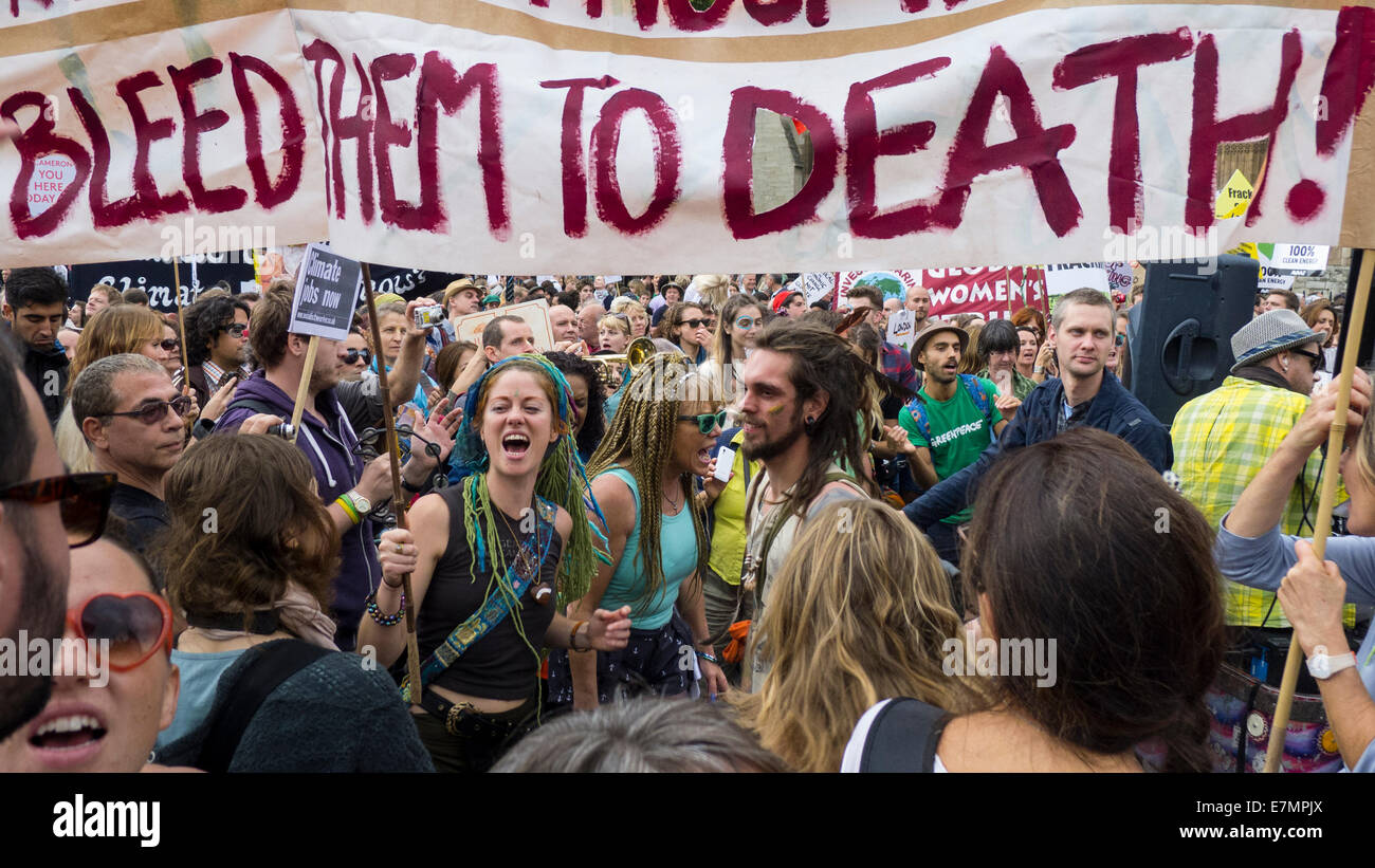 A group of demonstrators hold placards and a banner during the Climate Change demonstration, London, 21st September - Stock Image