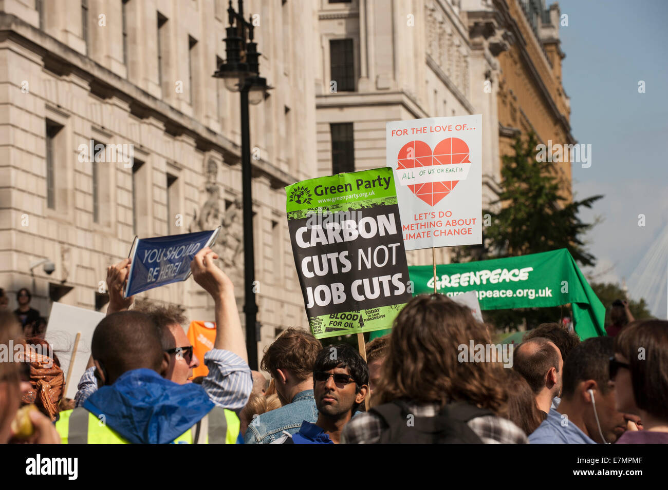 London, UK. 21st Sep, 2014. Marchers hold placards aloft at the Climate Change demonstration, London, 21st September - Stock Image
