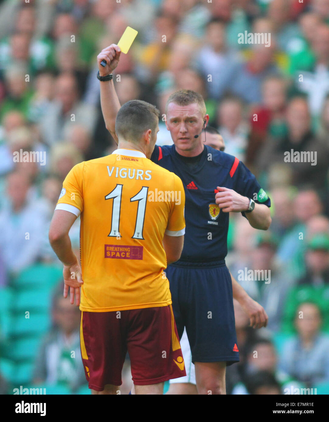 Glasgow, Scotland. 21st Sep, 2014. Scottish Premier League. Celtic versus Motherwell. Brian Colvin yellow cards - Stock Image