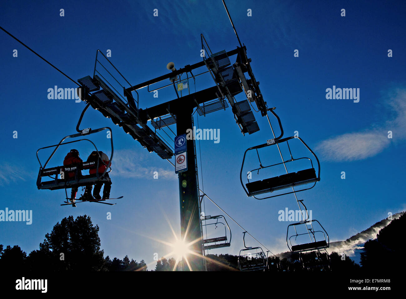 Chairlifts on their way to top of the mountain ski resort in Spain Stock Photo