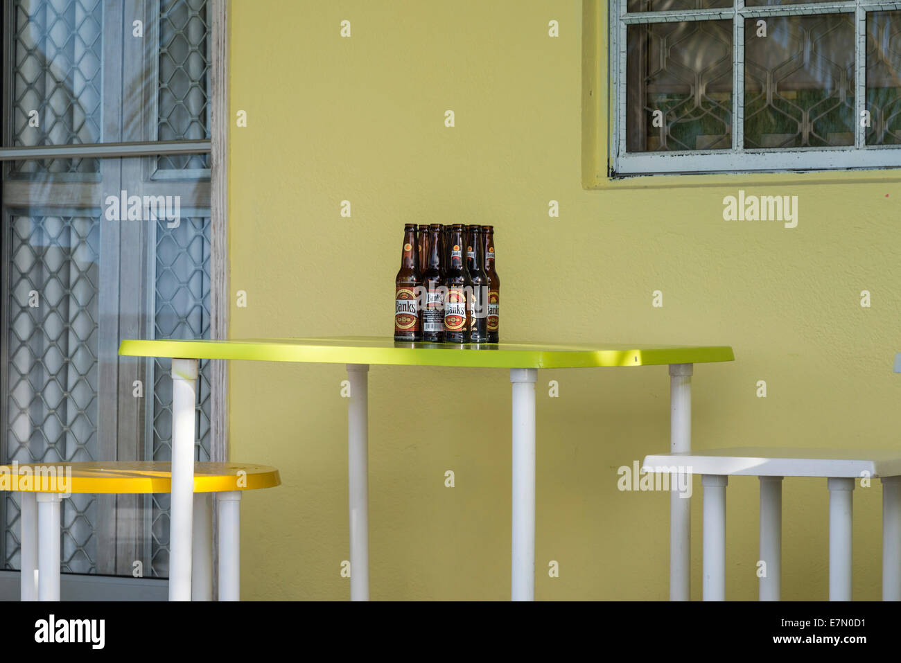 Empty bottles of Banks Beer grouped together on a table from the night before. EDITORIAL USE ONLY - Stock Image