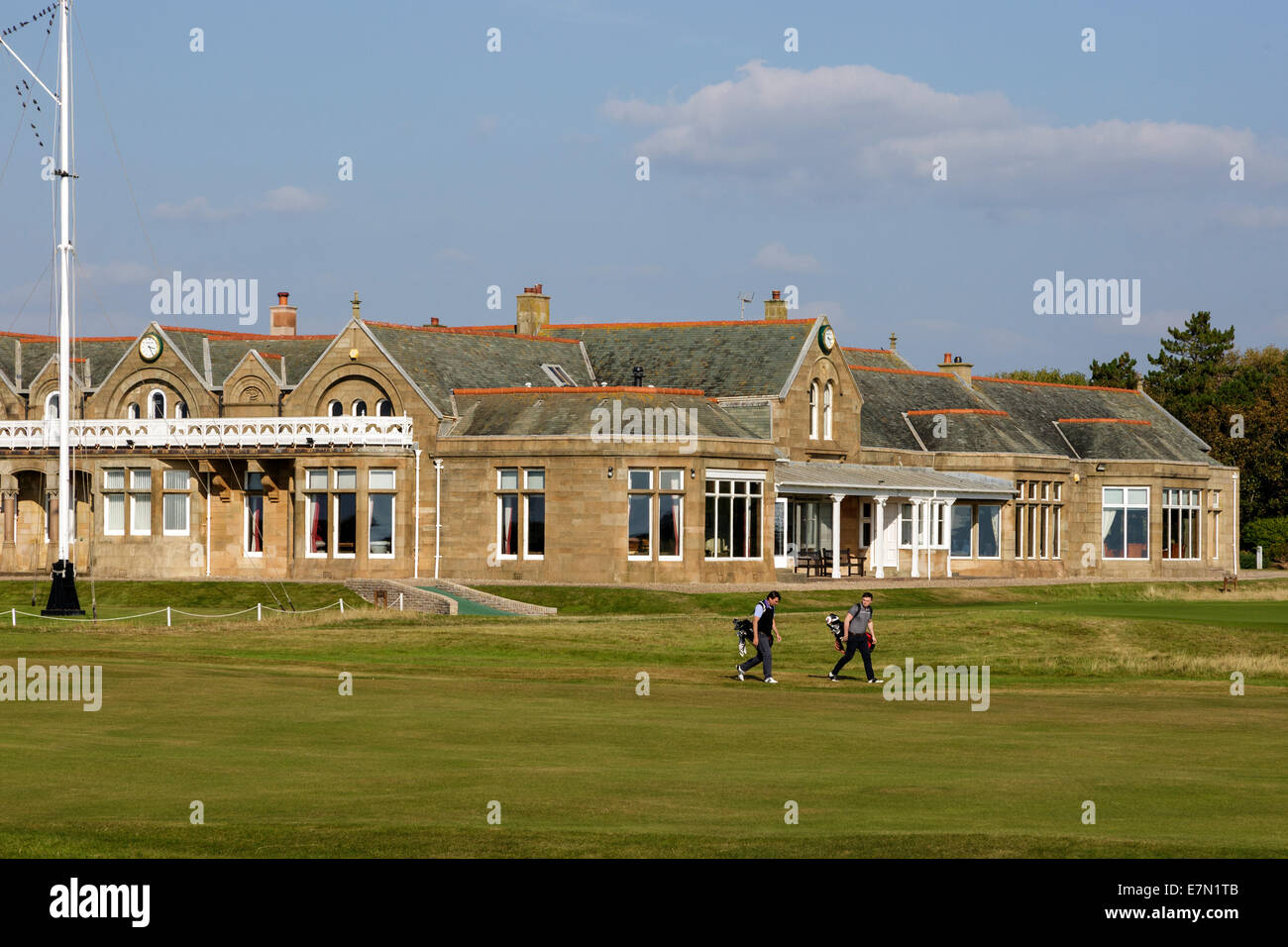 Golfers on the first fairway at Royal troon Golf Club with the clubhouse in the background, troon, Ayrshire, Scotland, - Stock Image