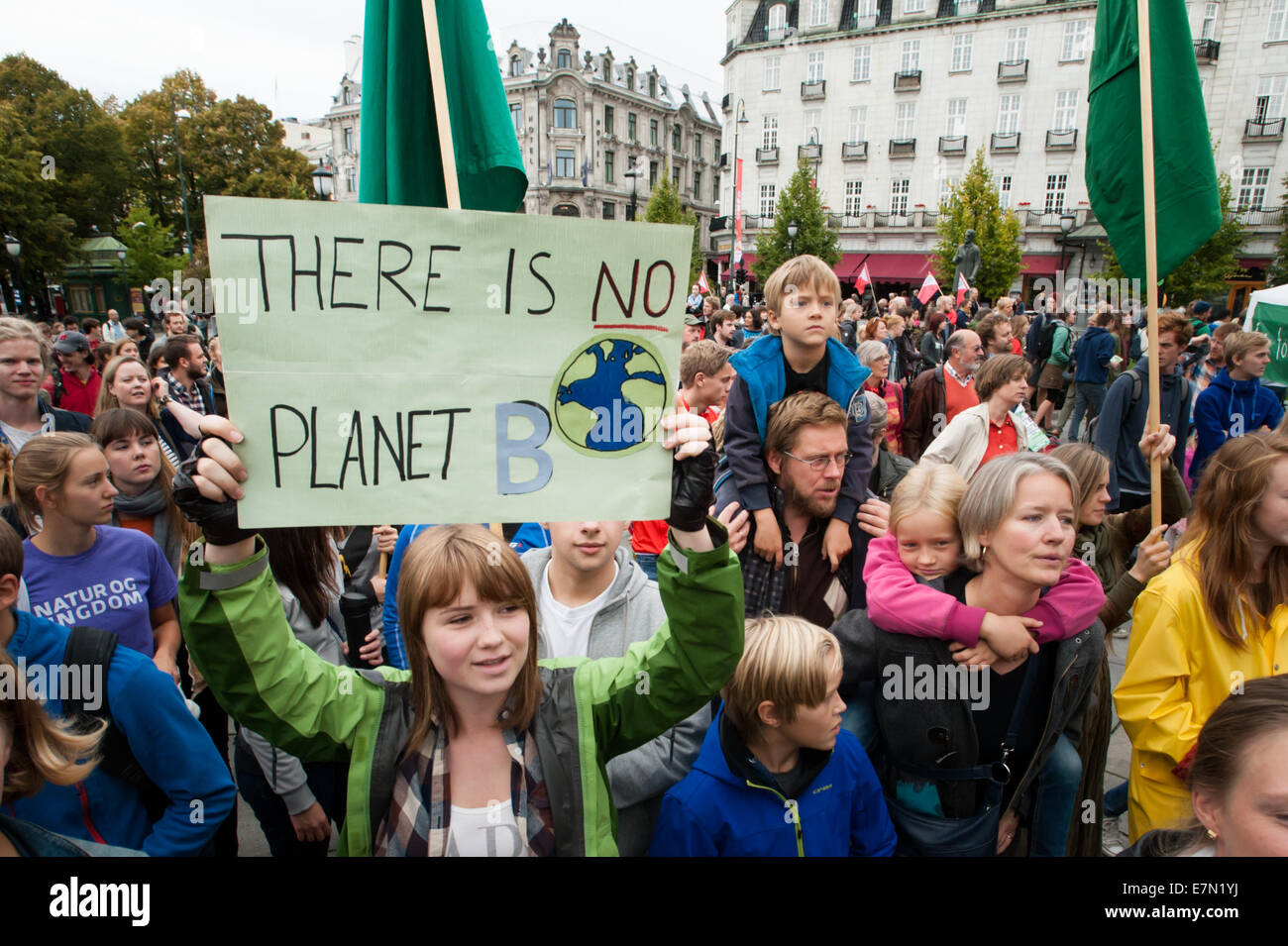 Oslo, Norway. 21st Sep, 2014. A sign reads, 'There Is No Planet B', as parents carry children among thousands - Stock Image