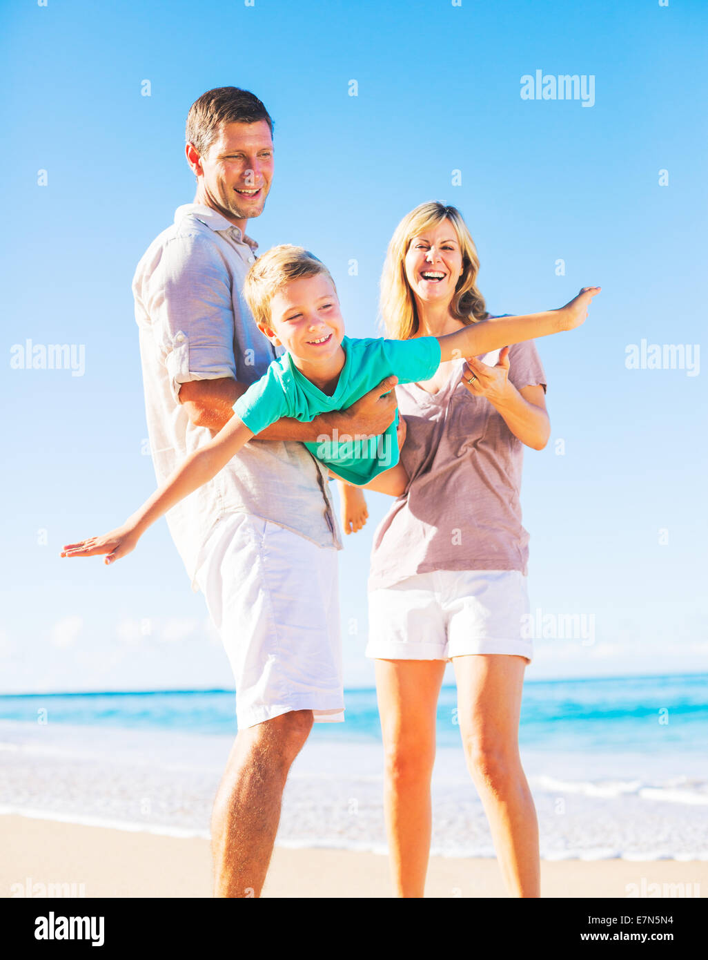 Family Playing on the Beach - Stock Image