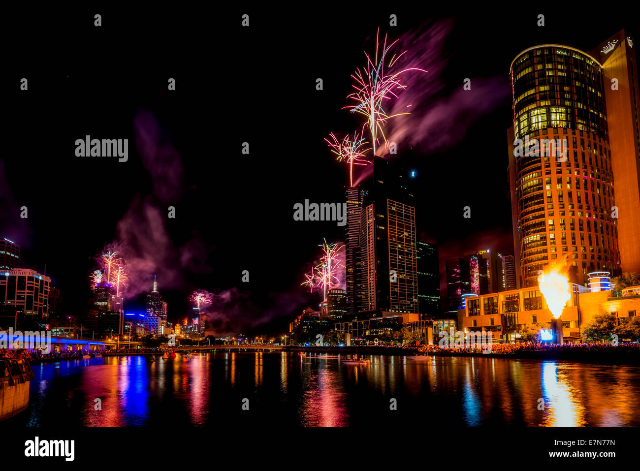 Spectacular fireworks along the Yarra River light up the night sky over Melbourne Australia. - Stock Image