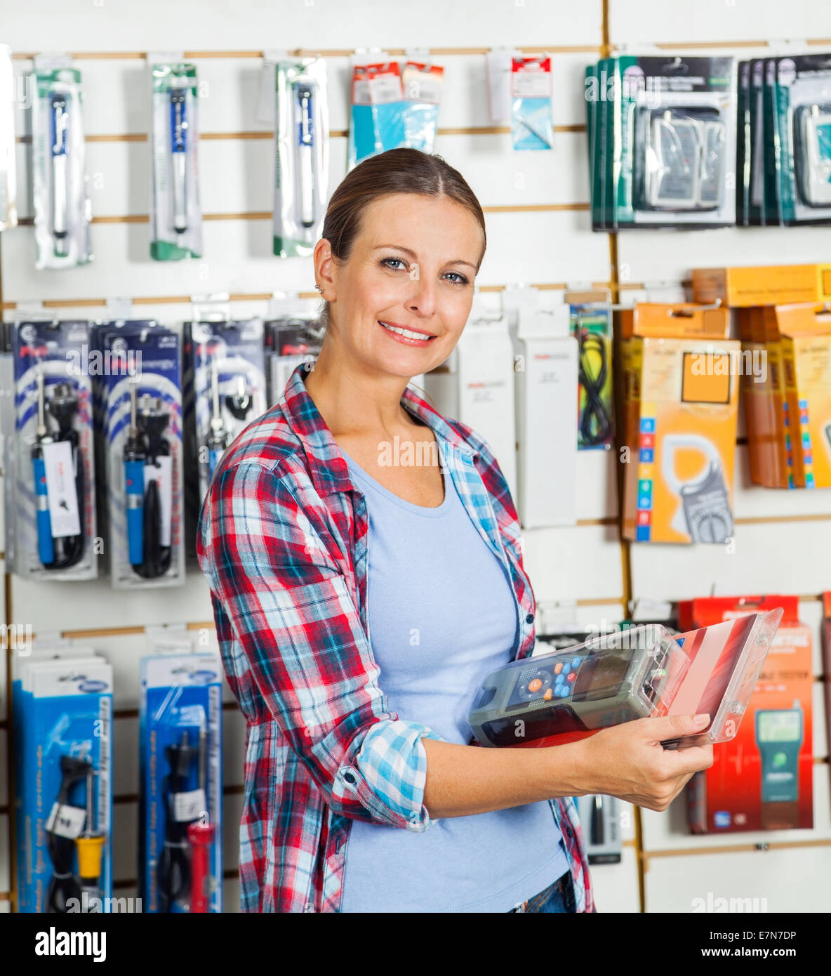 Customer Holding Packed Product In Hardware Store - Stock Image